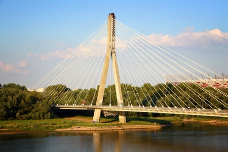Swietokrzyski Bridge over river Wisla. Sunset light Warsaw, Poland Imagens