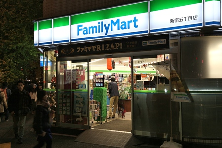 TOKYO, JAPAN - NOVEMBER 30, 2016: People visit FamilyMart convenience store in Tokyo, Japan. FamilyMart is one of largest convenience store franchise chains in Japan with 7,604 shops (2012).