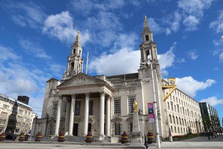 LEEDS, UK - JULY 12, 2016: People walk by Civic Hall in Leeds, UK. Leeds urban area has 1.78 million population.