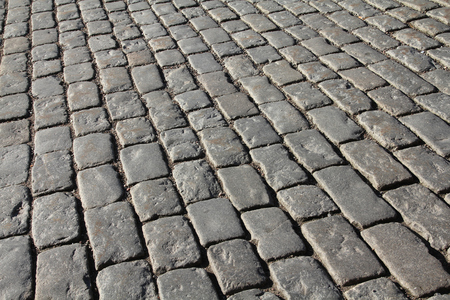 Stockholm granite cobblestone background texture. Cobbled square in Gamla Stan (the Old Town).