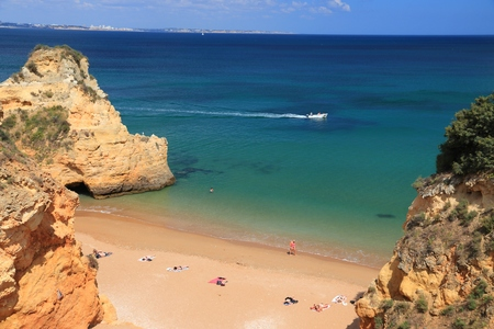 Portugal Atlantic coast landscape in Algarve region. Praia do Pinhao sandy beach.
