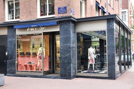AMSTERDAM, NETHERLANDS - JULY 10, 2017: Prada high fashion shop at P.C. Hooftstraat in Amsterdam. Pieter Cornelis Hooftstraat is the ultimate upscale shopping street in the Netherlands.
