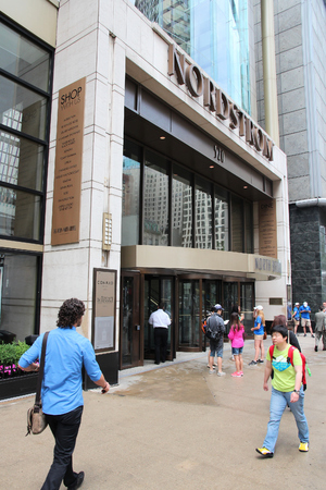 CHICAGO, USA - JUNE 26, 2013: Shoppers walk by Nordstrom department store at Magnificent Mile in Chicago. The Magnificent Mile is one of most prestigious shopping districts in the United States.