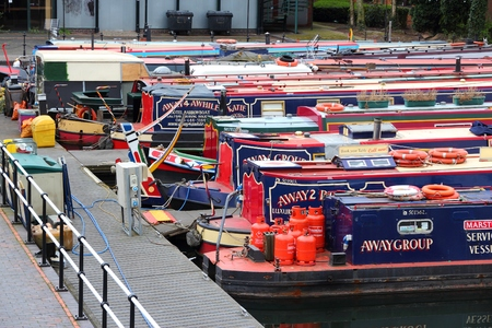 BIRMINGHAM, UK - APRIL 24, 2013: Narrowboats moored at Gas Street Basin in Birmingham, UK. Birmingham is the 2nd most populous British city. It has rich waterway and boat culture. Redakční