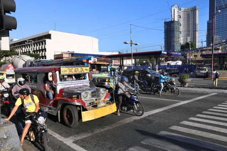 MANILA, PHILIPPINES - NOVEMBER 28, 2017: People drive in heavy traffic in Makati City, Metro Manila, Philippines. Metro Manila is one of the biggest urban areas in the world with 24 million people.
