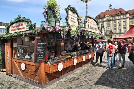 DRESDEN, GERMANY - MAY 10, 2018: People visit Fruhjahrsmarkt (Spring Market) in Dresden. Spring Markets are popular in Germany, selling local food, flowers and produce.