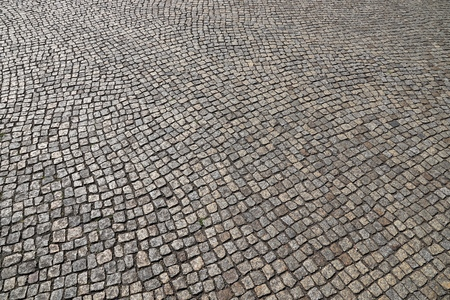 Stone paving background - granite cobblestone pattern in Dresden, Germany.
