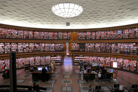 STOCKHOLM, SWEDEN - AUGUST 22, 2018: People visit the rounded building of Stockholm Public Library (Stadsbiblioteket). The library was opened in 1928.