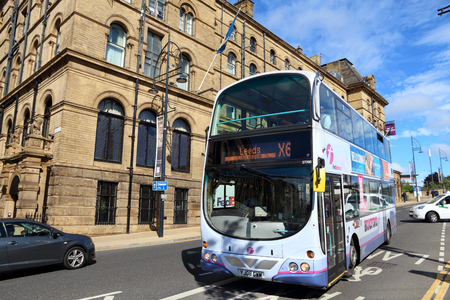 BRADFORD, UK - JULY 11, 2016: People ride First Bradford double decker bus. FirstGroup employs 124,000 people.