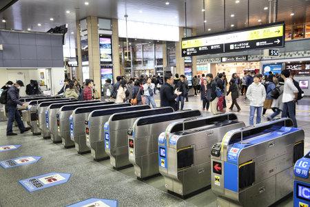 OSAKA, JAPAN - NOVEMBER 23, 2016: Passengers hurry at Tennoji Station in Osaka, Japan. JR West Tennoji Station served 143,202 passengers daily in 2015. Редакционное