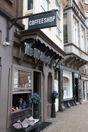 AMSTERDAM, NETHERLANDS - JULY 8, 2017: Coffee shop The Old Church in Amsterdam, Netherlands. Coffeeshops legally sell marijuana for personal consumption.