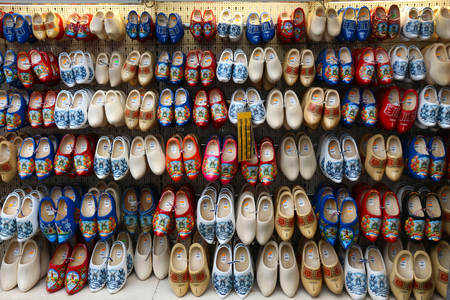 AMSTERDAM, NETHERLANDS - JULY 8, 2017: Dutch wooden shoes known as clogs at a gift store in Amsterdam. Decorative wooden clogs are a popular souvenir from the Netherlands.