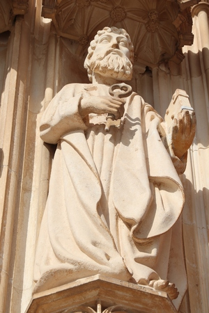 Saint Peter the Apostle statue. Batalha Monastery - medieval gothic landmark in Portugal.