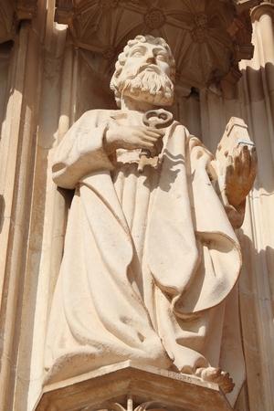 Saint Peter the Apostle statue. Batalha Monastery - medieval gothic landmark in Portugal.