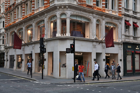 LONDON, UK - JULY 6, 2016: People walk by Bally fashion store at New Bond Street in London. Bond Street is a major shopping destination of West End in London.