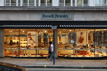 LONDON, UK - JULY 6, 2016: People walk by Russell & Bromley fashion store at New Bond Street in London. Bond Street is a major shopping destination of West End in London.
