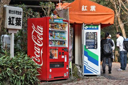 MINOO, JAPAN - NOVEMBER 22, 2016: Red Coca-Cola vending machine in Minoo, Osaka. Japan is famous for its vending machines, with more than 5.5 million machines nationwide.