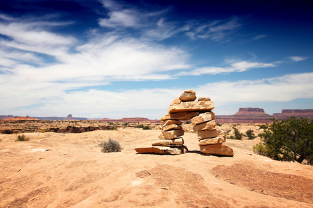 United States nature in Utah. Needles district of Canyonlands National Park - hiking trail marking cairns.