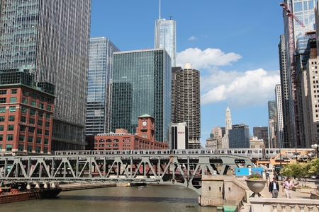 CHICAGO, USA - JUNE 27, 2013: Downtown skyline view with Chicago River. Chicago is the 3rd most populous US city with 2.7 million residents (8.7 million in its urban area).