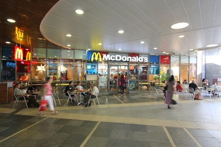 SOFIA, BULGARIA - AUGUST 17, 2012: People visit McDonald's fast food restaurant in Sofia, Bulgaria. McDonald's has some 36,900 restaurants in over 100 countries.