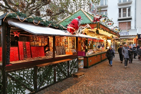 FRANKFURT, GERMANY - DECEMBER 6, 2016: People visit Christmas Market in Frankfurt, Germany. The tradition of Christkindlmarkt originates from Germany. Editorial