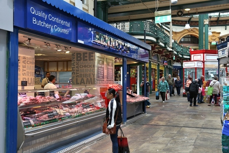 LEEDS, UK - JULY 12, 2016: People visit Leeds Kirkgate Market in the UK. There are 800 stalls in the market. It is visited by 100,000 weekly shoppers.