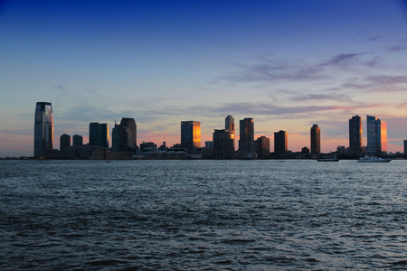 Jersey City, United States - NJ downtown skyline with Hudson river. Sunset light. 写真素材