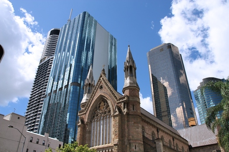 Brisbane city, Australia. Cathedral of Saint Stephen surrounded by skyscrapers.