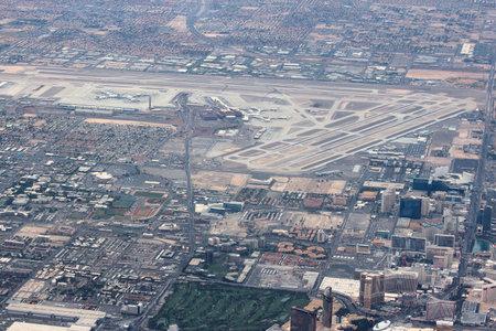 LAS VEGAS, USA - APRIL 15, 2014: Aerial view of Las Vegas McCarran airport and the famous Strip (Las Vegas Boulevard) on the right. Редакционное