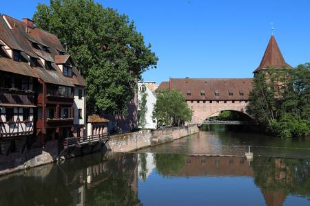 Nuremberg city, Germany - Schlayerturm medieval tower and Kettensteg (Chain Bridge).