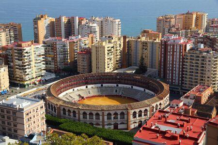 Malaga, Spain. Cityscape with hotels and bullring stadium. Stock Photo