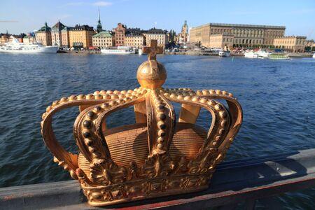 Stockholm city in Sweden. Decorative crown sculpture on Skeppsholmsbron bridge.