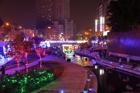 TAICHUNG, TAIWAN - DECEMBER 2, 2018: People visit Liuchuan Riverside Walk decorated for Christmas in Taichung, the second largest city in Taiwan (2.8 million inhabitants). Editorial