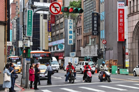 TAIPEI, TAIWAN - DECEMBER 5, 2018: Scooter riders in Taipei, Taiwan. Taipei is the capital city of Taiwan with population of 8.5 million in its urban area. Publikacyjne