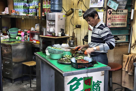 LUKANG, TAIWAN - DECEMBER 2, 2018: Betel nut seller in Lukang, Taiwan. Areca nuts with betel plant leaves are traditionally chewed throughout Southeast Asia. Editorial