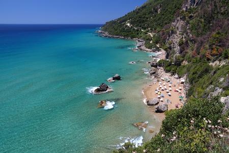 Corfu beach landscape - island in Greece. Myrtiotissa Beach below the cliffs.