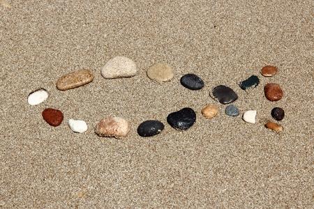 Christianity symbol - fish shape made of pebbles. Catholicism fish - ichthus.
