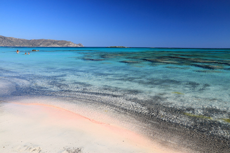 Beach landscape of Crete island in Greece. Pink sandy beach in famous Elafonisi (or Elafonissi).