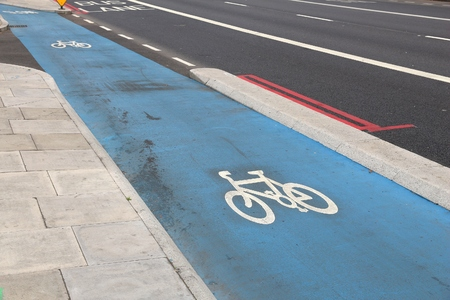 Cycling lane in the city - London, UK. Bike route.