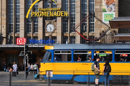LEIPZIG, GERMANY - MAY 9, 2018: Passengers visit the railway station (Hauptbahnhof) of Leipzig, Germany. At 83,460 square metres, it is the largest railway station by floor area worldwide.