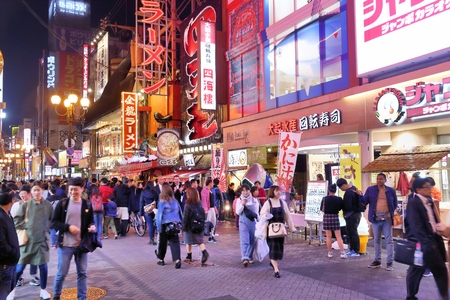 OSAKA, JAPAN - NOVEMBER 21, 2016: People visit Dotonbori street in Osaka, Japan. Dotonbori is the main entertainment area of Osaka.