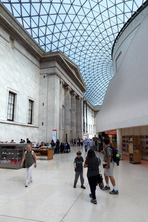 LONDON, UK - JULY 6, 2016: People visit British Museum Great Court in London. The museum was established in 1753 and holds approximately 8 million objects.