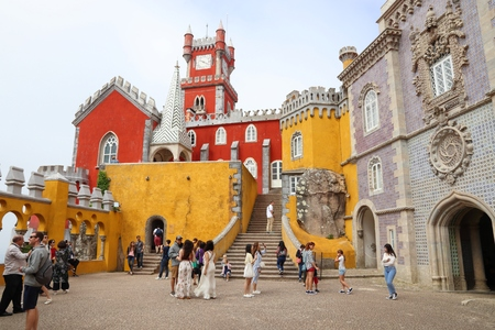 SINTRA, PORTUGAL - MAY 21, 2018: Tourists visit Pena Palace in Sintra. Portugal had 12.7 million foreign visitors in 2017.