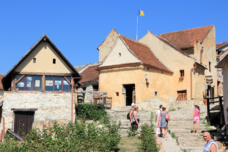 TRANSYLVANIA, ROMANIA - AUGUST 21, 2012: People visit Rasnov Castle in Transylvania region of Romania. Rasnov Citadel is a medieval historic monument from year 1225.