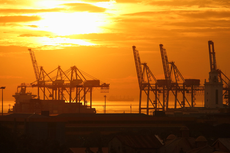 Port of Manila, Philippines. Seaport loading cranes in sunset light. 写真素材