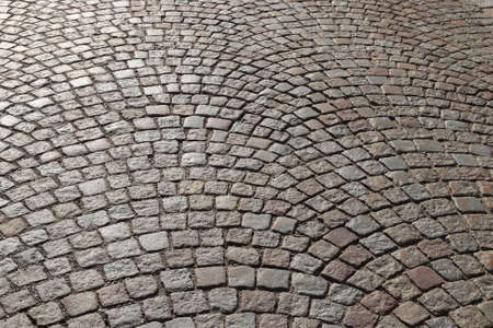 Stone paving background - granite cobblestone pattern in Stockholm, Sweden.