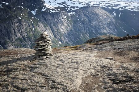 Norway hiking trail cairns marking - mountain range in Hordaland county. Troll's Tongue trail.