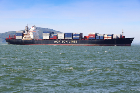 SAN FRANCISCO, USA - APRIL 8, 2014: Horizon Lines container ship sails in San Francisco bay. Horizon Lines was discontinued in 2015 after it was sold.