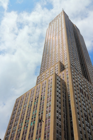 NEW YORK, USA - JULY 4, 2013: Empire State Building skyscraper in New York. The art-deco style 381m tall office building was the tallest building in the world for 40 years.