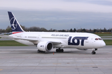 WARSAW, POLAND - APRIL 1, 2014: Boeing 787 Dreamliner aircraft of LOT Polish Airlines at Warsaw Airport, Poland. LOT carried 4.63 million passengers in 2011. Publikacyjne